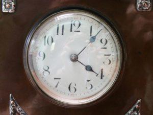 A E Jones copper and silver clock