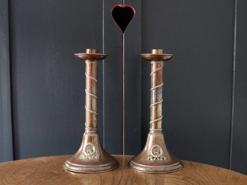 A E Jones copper candlestick