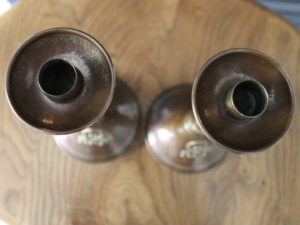 A E Jones copper candlesticks