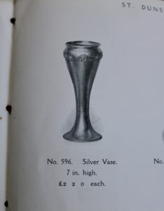 A E Jones silver motto vase