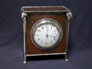 A E Jones bronze and silver clock
