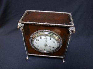 A E Jones bronze and silver clock