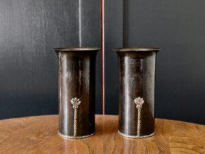 A E Jones copper and silver vases