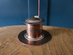 A E Jones copper and silver inkwell