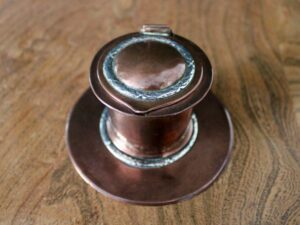 A E Jones copper and silver inkwell
